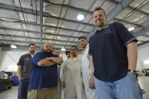 Team photo of body repair mechanics in Tacoma, WA.